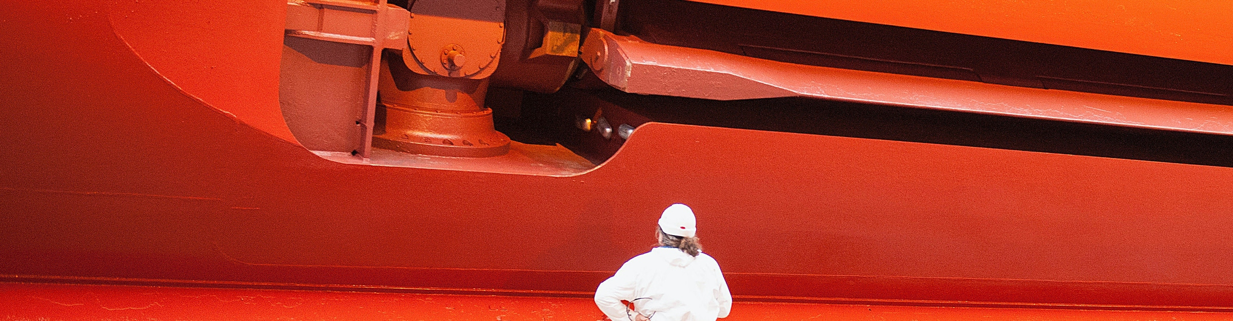 Close-up of worker looking at side of the Norwegian Star